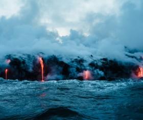 White smoke lava emerging from the volcano Stock Photo