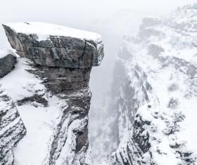 White snow covering high rocky mountain range Stock Photo