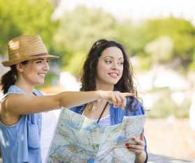 Woman Tourist with map asking directions Stock Photo