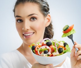 Woman eating salad mixed vegetables Stock Photo 01