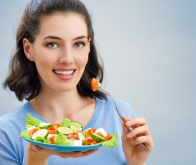 Woman eating salad mixed vegetables Stock Photo 02