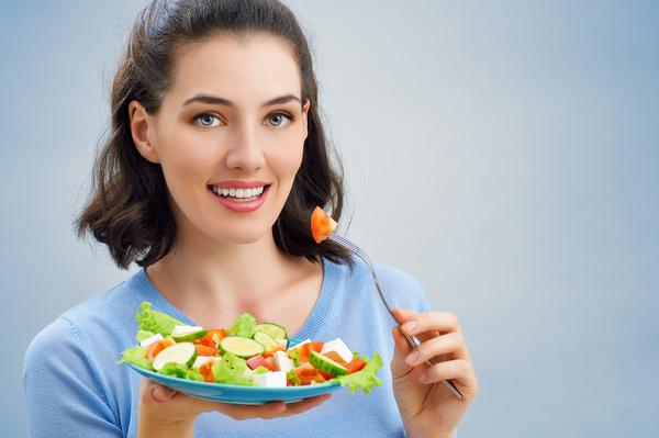 Woman eating salad mixed vegetables Stock Photo 02