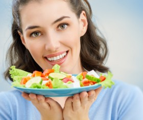 Woman eating salad mixed vegetables Stock Photo 03