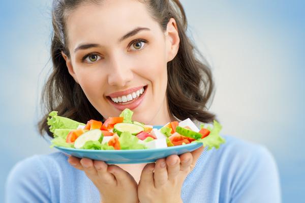 Woman eating salad mixed vegetables Stock Photo 03