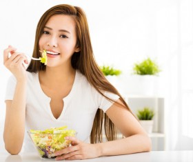 Woman eating salad mixed vegetables Stock Photo 05