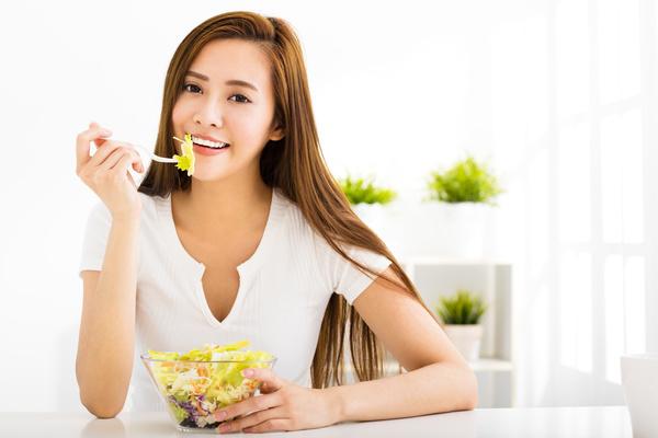 Woman eating salad mixed vegetables Stock Photo 05