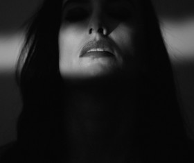 Woman face in darkness Stock Photo