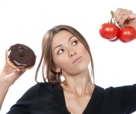 Woman holding tomatoes and cake Stock Photo