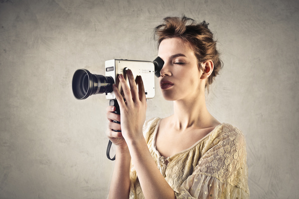 Woman holding video recorder Stock Photo