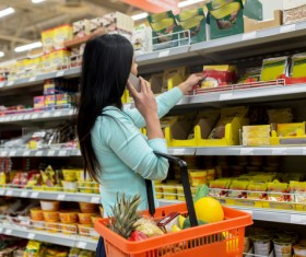 Woman in supermarket buying food calls Stock Photo 02