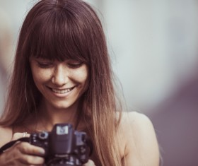 Woman-looking-at-camera-photo-Stock-Photo-280x235.jpg