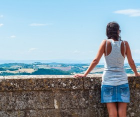 Woman looking at distant landscape Stock Photo