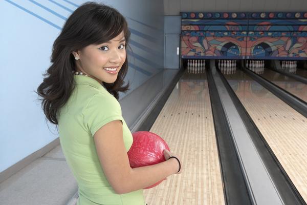 Woman playing bowling Stock Photo 01