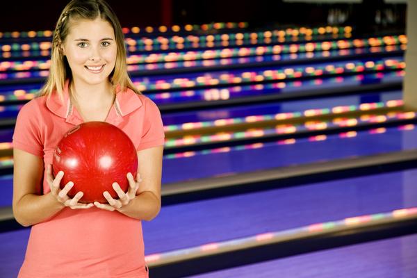 Woman playing bowling Stock Photo 02