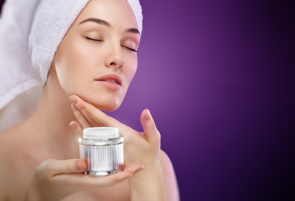 Woman rubs moisturizers and creams Stock Photo 01