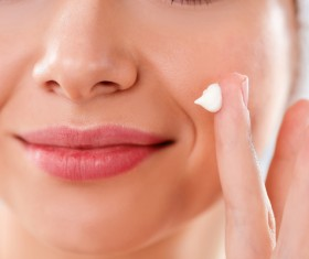 Woman rubs moisturizers and creams Stock Photo 02