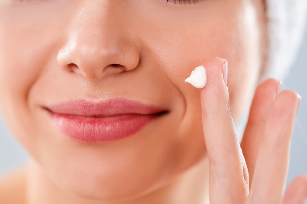 Woman rubs moisturizers and creams Stock Photo 02