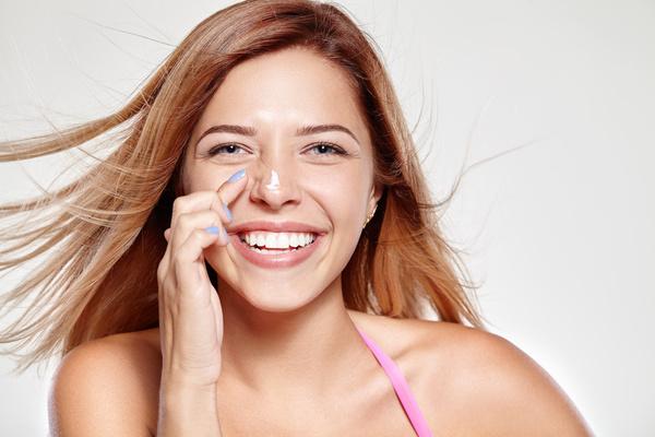 Woman rubs moisturizers and creams Stock Photo 04