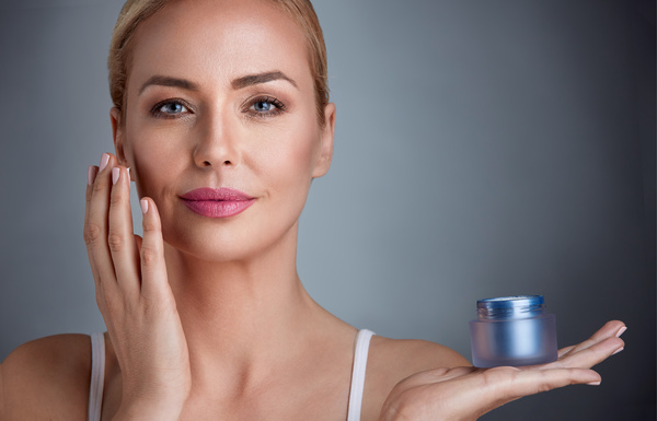 Woman rubs moisturizers and creams Stock Photo 05