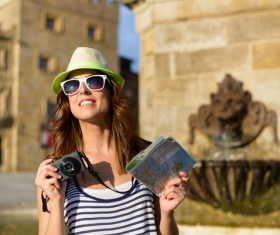 Woman tourist holding a camera and map Stock Photo