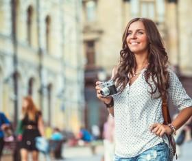 Woman tourist holding camera Stock Photo