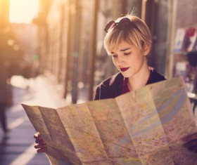 Woman tourist looking at city map Stock Photo 01