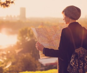 Woman tourist looking at city map Stock Photo 02