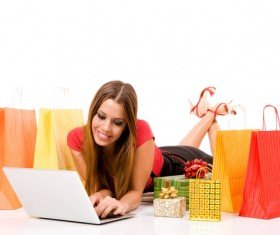 Woman using laptop for online shopping Stock Photo