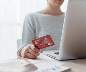 Woman using laptop for payment Stock Photo