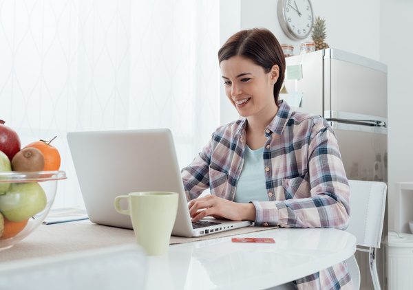 Woman using laptop online at home Stock Photo 02