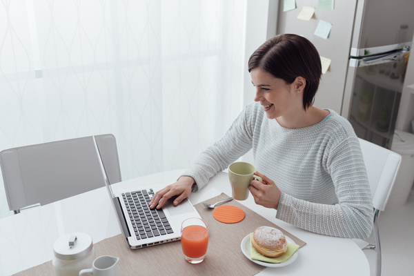 Woman using laptop online at home Stock Photo 03