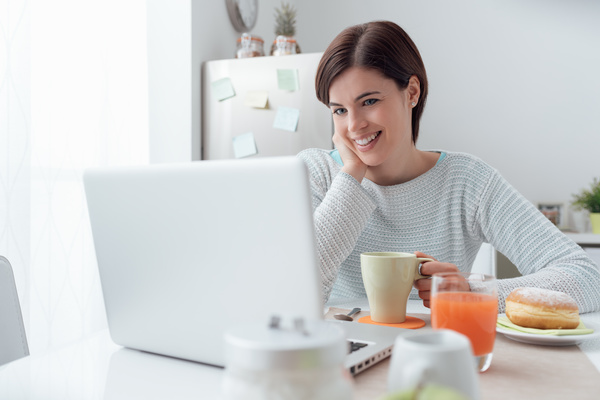 Woman using laptop online at home Stock Photo 04
