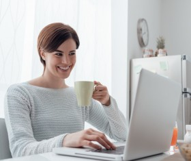 Woman using laptop online at home Stock Photo 05
