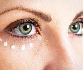 Woman wiping eye gel Stock Photo