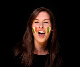 Woman with Italian flag painted on his face Stock Photo