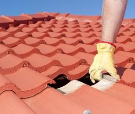 Worker repairing the roof Stock Photo 01
