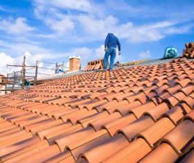 Worker repairing the roof Stock Photo 04