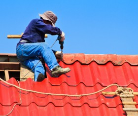 Worker repairing the roof Stock Photo 05