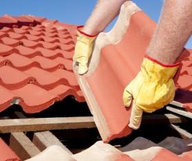Worker repairing the roof Stock Photo 09