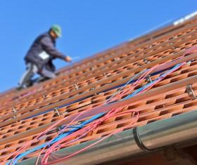 Worker repairing the roof Stock Photo 10