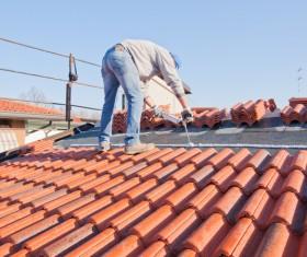 Worker repairing the roof Stock Photo 11
