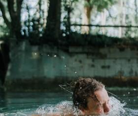 Young boy swimming on lake Stock Photo