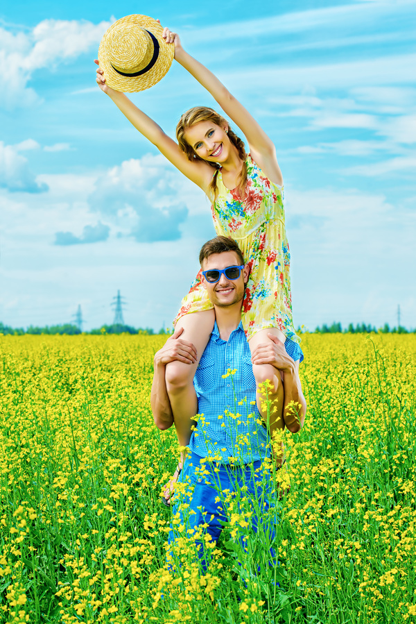 Young couple posing in flowers Stock Photo 01