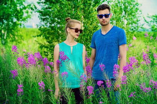 Young couple posing in flowers Stock Photo 02
