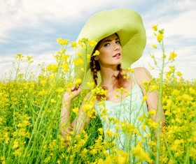 Young girl posing in flowers Stock Photo 01
