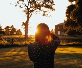 Young girl posing under sunlight Stock Photo