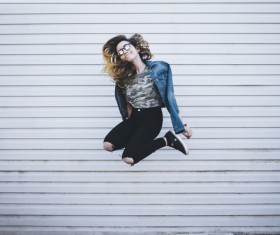 Young girl posing with jumping style Stock Photo