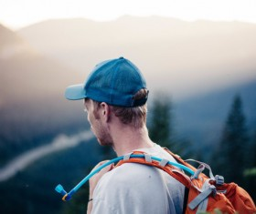 Young man traveling with backpack Stock Photo