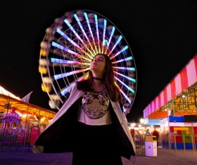 Young woman posing in amusement park Stock Photo