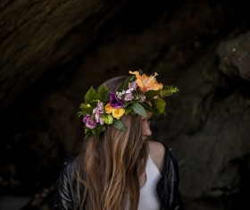 Young woman posing with flower wreath Stock Photo